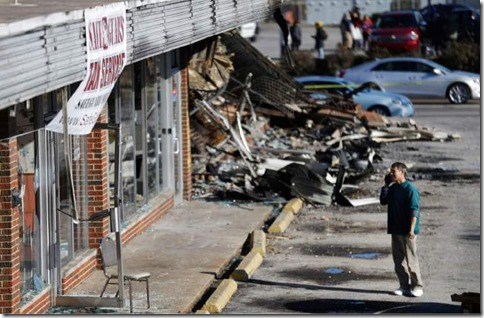 Shan-Zhao-owner-of-On-On-Chop-Suey-restaurant-looks-at-his-business-while-cleaning-up-Tuesday-Nov.-25-2014-in-Ferguson-Mo.-750x490